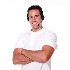 Attractive guy with headphones crossing his arms