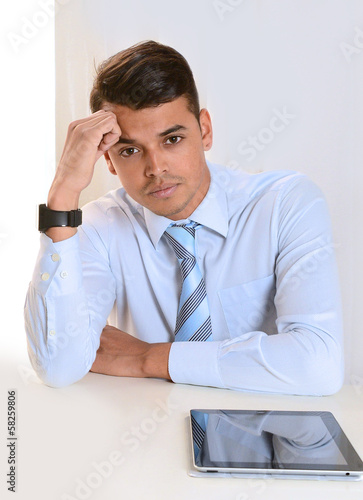 Young good looking business Man with Tablet