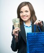 Happy young woman in a black jacket. Holds a gift bag and dollar