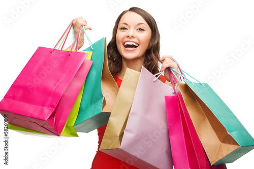 woman in red dress with colorful shopping bags