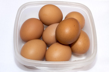 Some Eggs On The Table With White Base