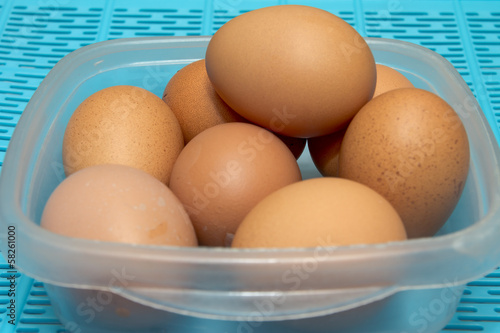 Some Eggs On The Table With Blue Base