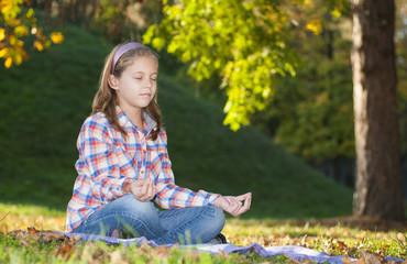 Girl meditating in the park