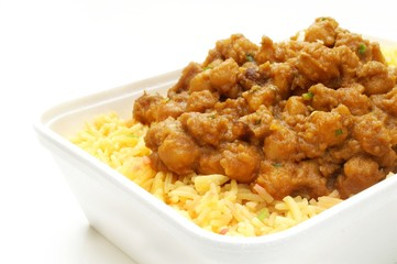 indian chana massala curry in take away tray