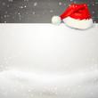 Karte im Schnee mit Nikolausmütze