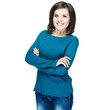 Attractive young woman in a blue shirt. Standing with folded han