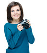 Attractive young woman in a blue shirt. Holds the camera. Isolat