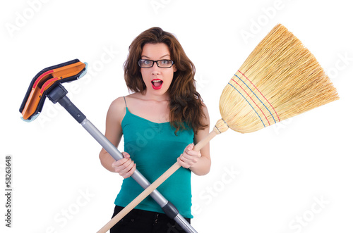 Young housewife doing housekeeping on white