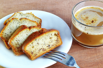 banana cake and a cup of coffee
