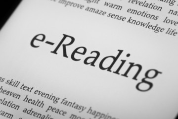 eReader with backlit screen. Shallow depth of field