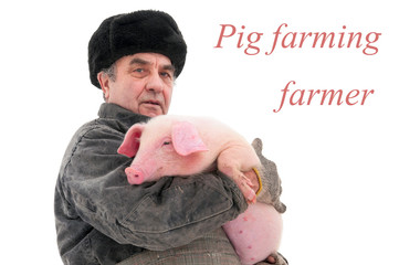 Farmer holding a pig. age 60-70 years. isolate