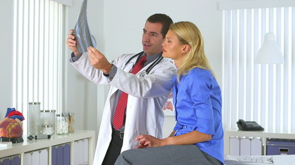 Male doctor reviewing patient's x-ray