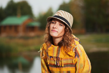 Young rastafarian woman in autumn park