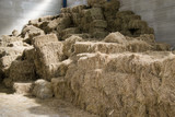 A huge hay stack in a barn