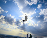 Silhouette the snowboarder in the sky