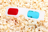 3D glasses on popcorn background