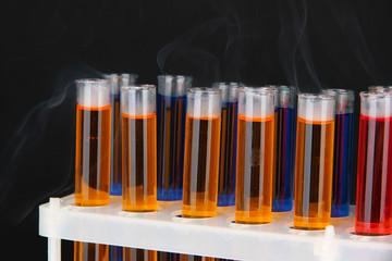 Laboratory test tubes on black background