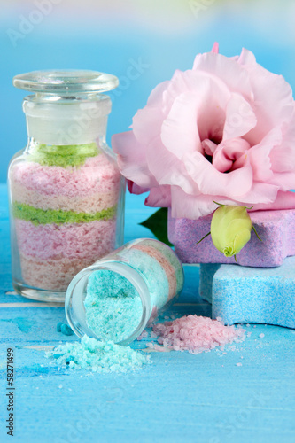 Aromatic salts in glass bottles,  on blue background