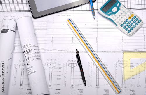 Architectural plans with drawing equipment