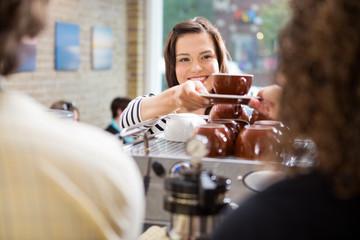 Customer Taking Coffee From Barista
