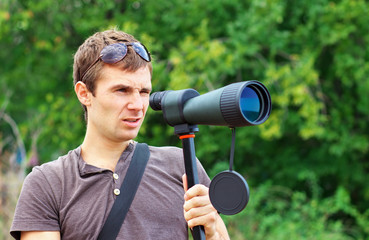 Man with spotting scope.