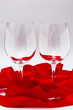 Empty wineglasses with red ribbon