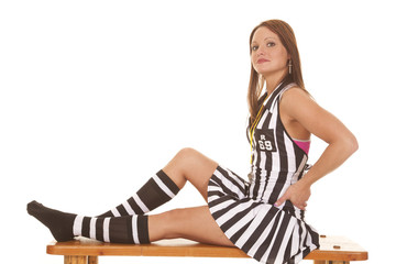 Woman referee sit side hands hips
