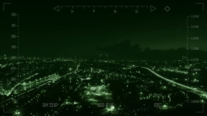 Drone flying over city at night
