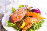 Full Cooked Tilapia Served with Vegetables and Fish Sauce Compli poster