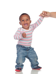 Beautiful African American baby learning to walk