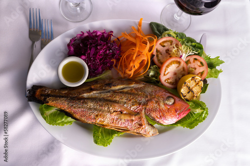poster of Full Cooked Tilapia Served with Vegetables and Fish Sauce Compli