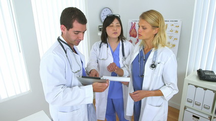 Team of doctors reviewing their notes