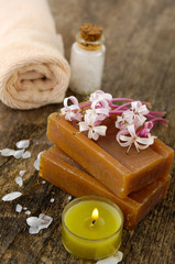 flower, candle, roller towel ,stones, soap on old wood