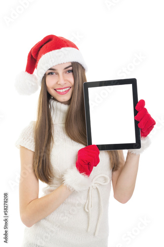 Happy teenage girl showing blank tablet computer