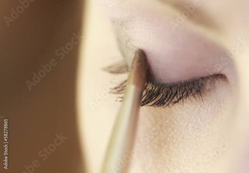 Part of face female eye makeup applying with brush