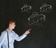 Businessman pointing at chalk flying piggy banks on blackboard