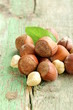 heap hazelnuts (filberts) on wooden background