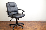 Black leather office chair in room