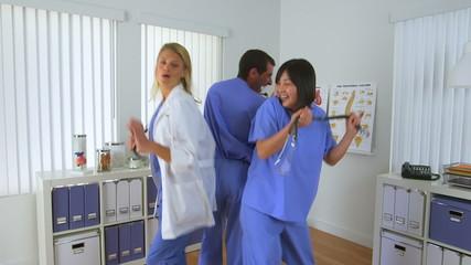 Team of doctors dancing in the office