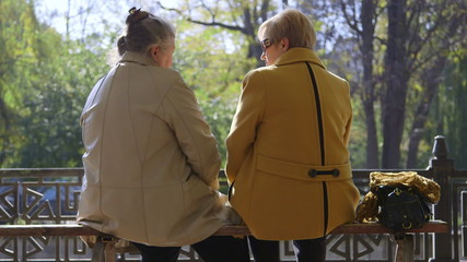 Senior women enjoy autumn day in the park