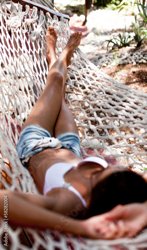 Young woman in hammock.
