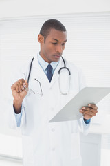 Serious male doctor writing a prescription