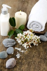 spa set with candle ,towel , flower, stones , massage oil