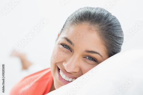Pretty young woman resting in bed