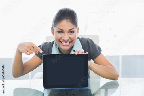 Smiling businesswoman displaying tablet PC