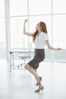 Cheerful elegant businesswoman cheering in office