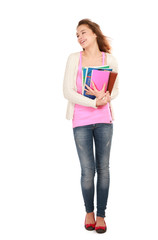 A smiling female student holding books