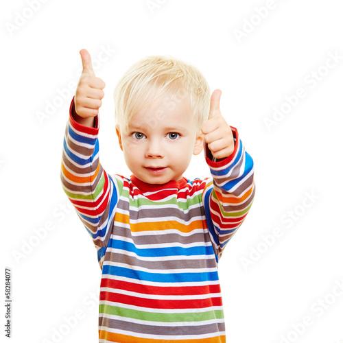 Leinwanddruck Bild Kind hält beide Daumen hoch