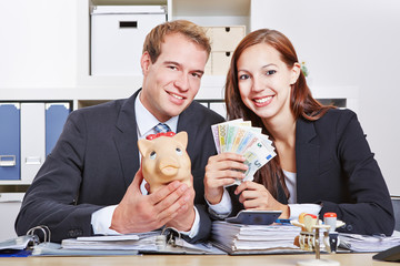 Business people with money and piggy bank