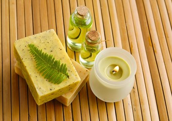 handmade soap with fern,candle on wooden mat